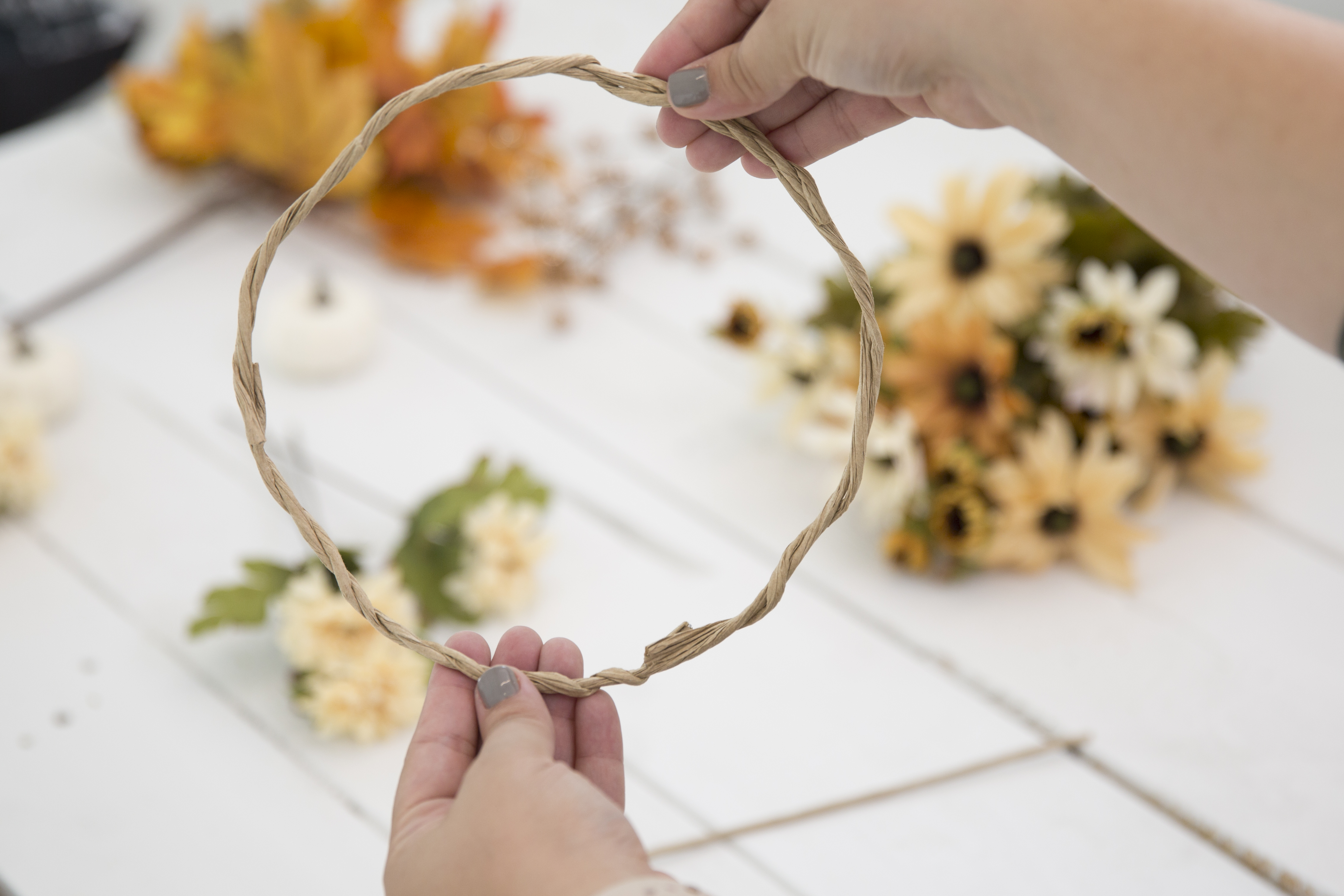Diy fall flower crown measure out how much wire you will need to fit around your head then twist the wire together to create a circle izmirmasajfo